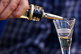 closeup of hands stock photography | Sweden, Man pouring a glass of Aquavit, image id 5-730-3637