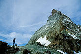 one man only stock photography | Switzerland, Alps, Hiker looking at the East face of the Matterhorn, image id 2-104-25
