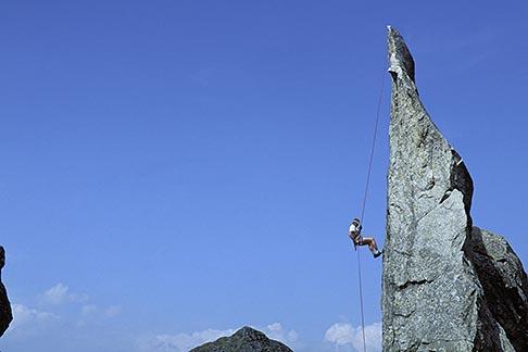 image 2-98-7 Switzerland, Bergell, Mark McCall rappelling on La Fiamma
