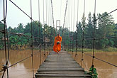 southeast stock photography | Thailand, Sukhothai, Monks on bridge, Si Satchanalai town, image id 0-381-14