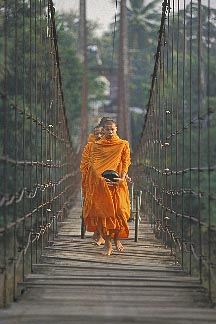 0-383-11  stock photo of Thailand, Sukhothai, Monks on bridge, Si Satchanalai town