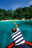 man on beach stock photography | Thailand, Similan Islands, Approaching a small island on a Zodiac launch, image id 7-524-18