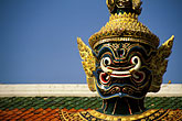 temple building detail stock photography | Thailand, Bangkok, Statue of a yaksha (demon), Wat Pra Keo, image id S3-101-1