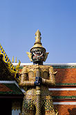 temple building detail stock photography | Thailand, Bangkok, Statue of a yaksha (demon), Wat Pra Keo, image id S3-101-2