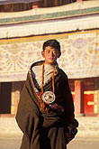 young person stock photography | Tibet, Young Tibetan pilgrim, Labrang Monastery, Xiahe, image id 4-124-26