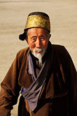 on foot stock photography | Tibet, Tibetan pilgrim, Labrang Monastery, Xiahe, image id 4-128-2