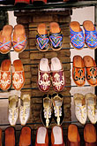 souvenirs in shop stock photography | Tunisia, Tozeur, Shoes in market, image id 3-1100-101