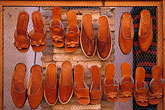 wire fence stock photography | Tunisia, Tozeur, Sandals in market, image id 3-1100-11