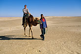 on foot stock photography | Tunisia, Nefta, Riding a camel, image id 3-1100-13