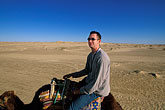 sand dune stock photography | Tunisia, Nefta, Riding a camel, image id 3-1100-14
