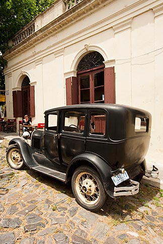 image 8-802-4322 Uruguay, Colonia del Sacramento, Abandoned antique automobile on cobbled street