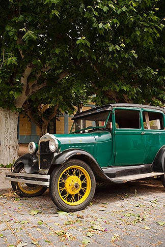 image 8-802-4381 Uruguay, Colonia del Sacramento, Abandoned antique automobile on cobbled street