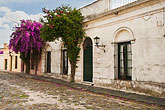 horizontal stock photography | Uruguay, Colonia del Sacramento, Cobbled side street with colonial architecture, image id 8-802-4424