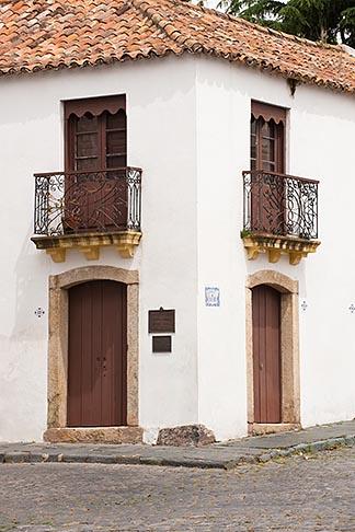 image 8-803-4662 Uruguay, Colonia del Sacramento, Ornate balcony, street corner, Historic District