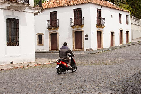 image 8-803-4667 Uruguay, Colonia del Sacramento, Motorbike on cobbled street, Historic District