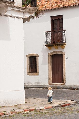 image 8-803-4673 Uruguay, Colonia del Sacramento, Small boy on street corner, Historic District