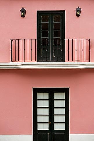 image 8-803-4754 Uruguay, Colonia del Sacramento, Balcony above black door, restored historic building, UNESCO site