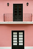 restored stock photography | Uruguay, Colonia del Sacramento, Balcony above black door, restored historic building, UNESCO site, image id 8-803-4754