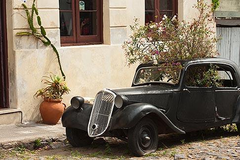 image 8-803-4781 Uruguay, Colonia del Sacramento, Abandoned antique automobile on cobbled street