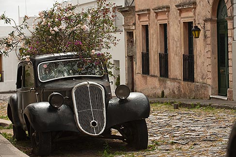 image 8-803-4791 Uruguay, Colonia del Sacramento, Abandoned antique automobile on cobbled street