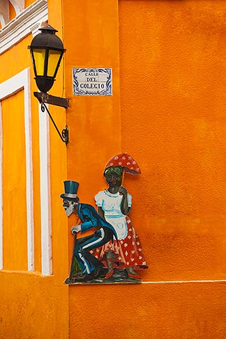 image 8-803-4838 Uruguay, Colonia del Sacramento, Single lamp and sign on orange wall, Historic District