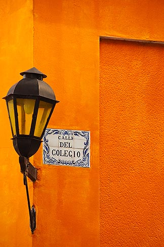 image 8-803-4840 Uruguay, Colonia del Sacramento, Single lamp and sign on orange wall, Historic District