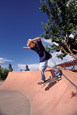 adolescent stock photography | Recreation, Skateboarder in quarter-pipe, image id 6-223-36