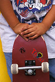 two boys stock photography | Recreation, Skateboarders hands, image id 6-239-25