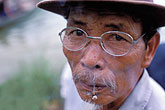 closeup portrait stock photography | Vietnam, Hoi An, Man smoking, image id S3-194-15