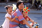 happy stock photography | Vietnam, Hoi An, Family on scooter, image id S3-194-16